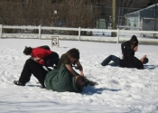 Students grappling in the snow