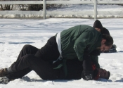 Pierre grappling with Daniel in snow