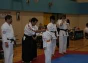 Xavier receiving his gold medal in Kata