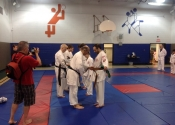 Belt level promotions Tokon Dojo June 2015 Beaconsfield - receiving belt from Sensei Manoli