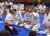 Sensei Manoli receiving 6th Dan in Kenkokan and 7th Dan in Koshiki