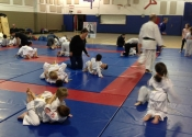 Bully-proofing and karate class for parents and children. Beaconsfield Recreation Centre. Dec. 2017. Beautiful to see all these hard working kids and parents. We develop an 'Attitude' based training backed by technical knowledge of what to do if bullied. Sensei Manoli guiding his young students. Parents learn and encourage the children in the class.