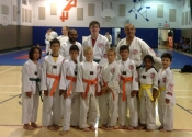 Congratulations - promoted to their belt level. Bottom row from L to R: Julian (green belt), Ian, Sean, Ethan, Owen, Joshua (orange belt), Saanvi & Luca (yellow belt). In the back row there is Maxime promoted to green belt. Keep up the good work. Practice bring improvement. June 2018. Beaconsfield Recreation Centre.