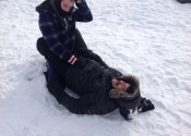 Not easy grappling in the snow with all that gear on. We were blessed with the beautiful Canadian weather. Beaconsfield Recreation Centre, Montreal, Qc. November 2018. www.manoli.ca.    Getting out of the guard.