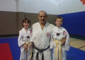 Two Students receive their yellow belt promotion