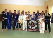 Group picture with the Arena BJJ logo
