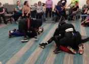 Morneau/Chepell 'hands-on', simulation oriented, women's self-defence workshop. Second group of wild, motivated and determined women. Downtown Montreal, Canada. Most attacks end up in a horizontal position (ground, bed, table...). Know what to do if brought to the ground - Oct. 2019