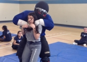 Marie Clarac high school for girls. Women's self-defence course. Target selected, move in for the attack. May, 2018